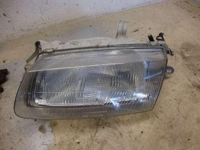 Scheinwerfer li  Mazda 323 BA Bj 95